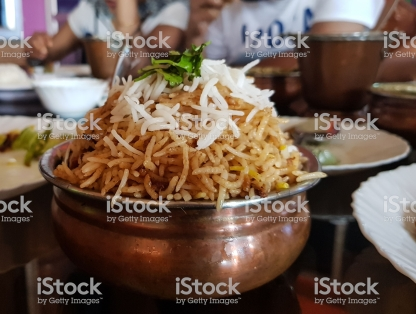 Handi Biryani In a local indian restaurant garnished with coriander