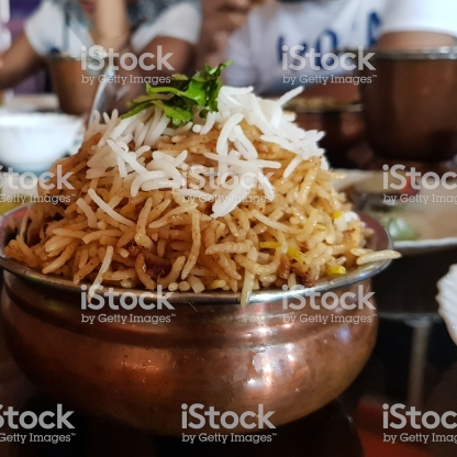 Handi Biryani In a local indian restaurant garnished with coriander